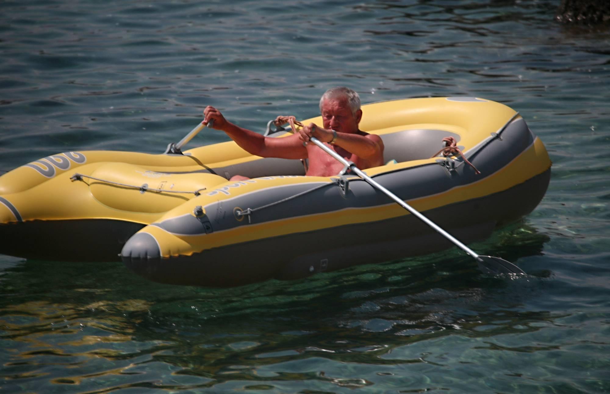 Lone Nudist in Yellow Boat - 2