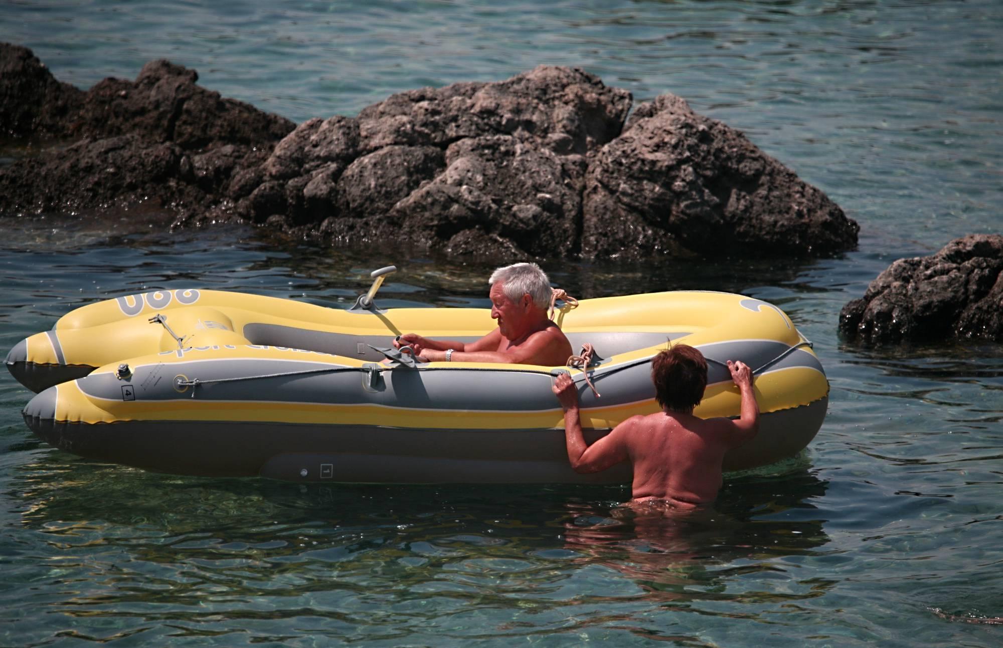 Lone Nudist in Yellow Boat - 1