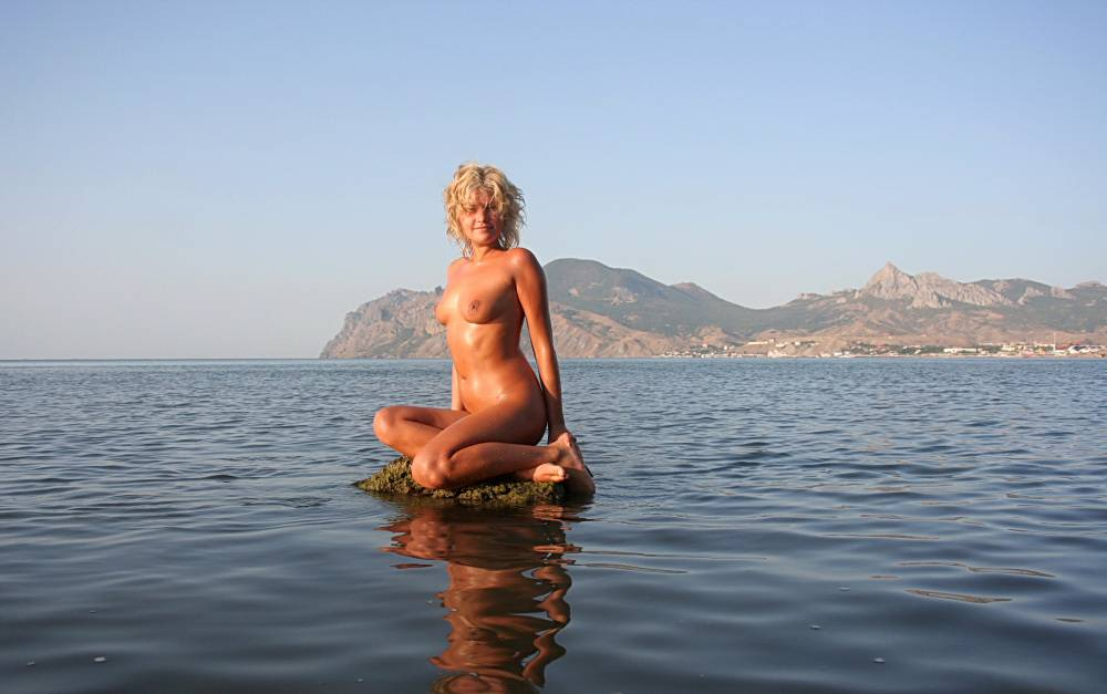 Pure Nudism Images Laying On Some Pebbles - 2