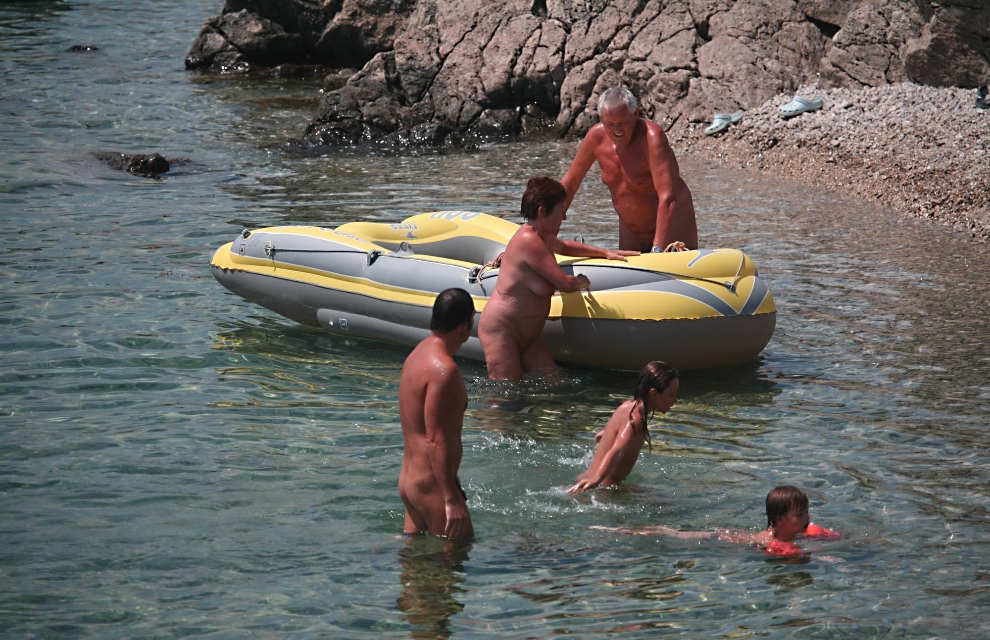 Purenudism Gallery Lone Nudist in Yellow Boat - 3