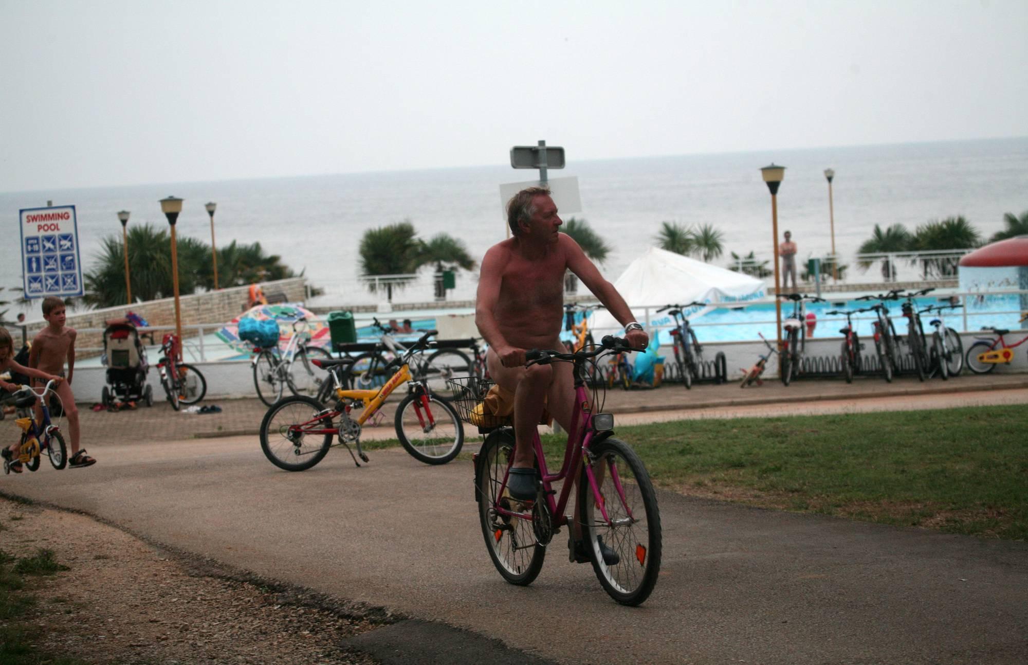 Naturist Poolside Biking - 1